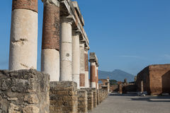 Row of Columns in Pompeii with Vesuvius in Background Royalty Free Stock Image