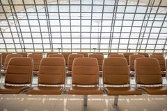 Row of comfortable brown seats for waiting in airport for background royalty free stock photography