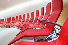 Row of comfortable seats in empty room Stock Photos