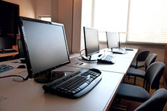 Row of computers. Row of desktop PCs workplaces in the classroom Stock Photo