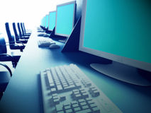 Row of computers on desk Royalty Free Stock Images