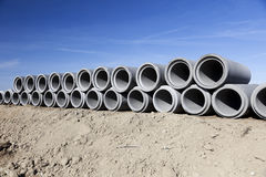 Row of concrete pipes. Blue sky. Stock Photography