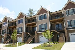 Row Of Condos. Row of new condos with garages Royalty Free Stock Images