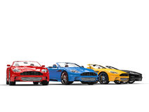 Row of convertible sports cars - studio shot Stock Images