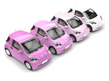 Row of cool urban modern compact cars in shades of pink Stock Photo