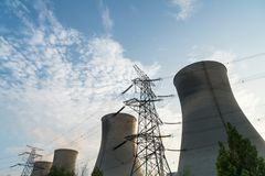 A row of cooling tower at dusk Stock Images