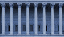 A row of corinthian columns of a public law court in Lyon, France - blue color tone Royalty Free Stock Photography