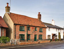 Row of Cottages. Quaint Row of Cottages in an English Village Street Stock Images