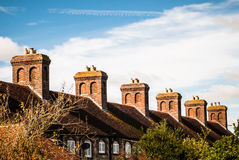 Row of cottages with brick chimneys Royalty Free Stock Images