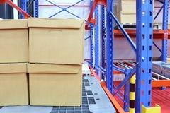 row of cotton boxes kept in warehouse shelves royalty free stock photos