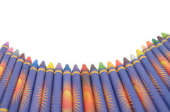 Row of Crayons. A row of crayons rounded along the bottom of the page which can be used for school awards, back to school promotions and you can add any text to stock image
