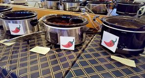 Row of crock pots in chili cook-off contest. In restaurant stock photo