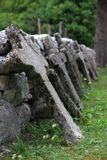 Row of crosses. The concrete crosses lay by the fence. Picture from military cemetery in Soča, Slovania. It is Austrian cemetery from world war one Stock Images