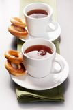 Row of cups. Of tea with bread-rings near by Royalty Free Stock Photography