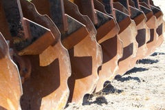 Row of curved steel disc blades Royalty Free Stock Images