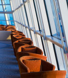 Row of cushioned seats or chairs by windows Royalty Free Stock Photography
