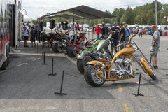 Row of custom motorcycles. Picture of a row of custom motorcycles during the grand national show at sanair, quebec, canada august 29-30 2015 Royalty Free Stock Images