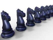 A row of dark blue chess knights. 3D rendered illustration of multiple dark blue chess knights arranged in a row. The composition is  on a white background with Royalty Free Stock Image