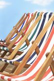 Row of deck chairs on beach stock photo