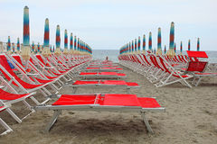 Row of deckchairs in front of the sea. A row of deckchairs in front of the sea Royalty Free Stock Images
