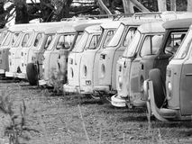 Row of defunct and run down desolate vans of all type Stock Images
