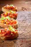 Row of delicious bruschetta Stock Photography