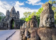 Row of demons statues in the South Gate of Angkor Thom complex, Siem Reap, Cambodia Royalty Free Stock Photos