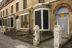 Row of derelict abandoned hous. Row of derelict boarded up abandoned houses Royalty Free Stock Photo