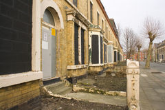 Row of derelict abandoned hous. Row of derelict boarded up abandoned houses Royalty Free Stock Image