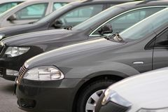 Business new cars parked ona parking in front of motor dealer store royalty free stock photo