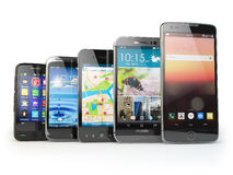 Row of the different smartphones isolated on white. Stock Images