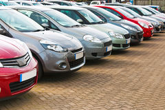 Row of different used cars. Line up of various types of used cars for sale on a motor dealers forecourt all marques removed Royalty Free Stock Image