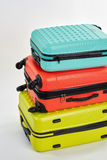 Row of different wheeled suitcases. Stock Photography