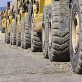 Row of diggers. A row of diggers on a construction site Royalty Free Stock Photos