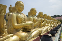Row of disciple statues surrounding Big buddha statue. As Macha Bucha Posture royalty free stock photography