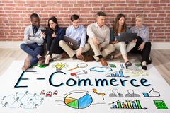 Ecommerce Concept With Businesspeople. Row Of Diverse Businesspeople With Ecommerce Plan On Floor Stock Image