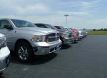 Row of 2016 Dodge Ram Pickups. Brand new 2016 Dodge Pickups side view on dealership lot at Blue Ribbon Chrysler Dodge Jeep in Sallisaw, Oklahoma royalty free stock images