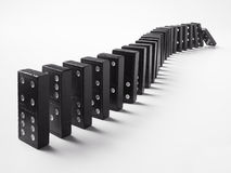 A row of dominoes. With one falling over Stock Images