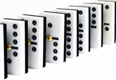Row of dominoes. Row of black and white dominoes pieces on white background royalty free stock photo