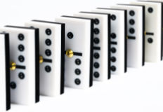Row dominoes. Row of black and white dominoes on white background royalty free stock images
