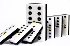 Row of dominoes. Falling domino stopped by a major piece Stock Images