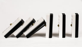 Row dominoes. Dominoes falling and hitting each other royalty free stock image