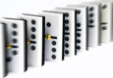 Row of dominoes. In which emphasizes over and the rest is unfocused Stock Photos