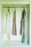Row of dress hanging on coat hanger Royalty Free Stock Photo