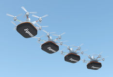 Row of drones carrying containers  for fast delivery concept Royalty Free Stock Photography
