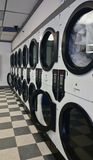 Row of dryers in a laundromat. royalty free stock photo