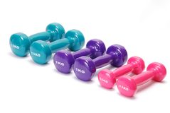 Row of dumbbell weights stock image