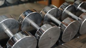 Row of dumbbells in gym.  stock video