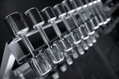 Row of dumbbells in modern sports fitness club Stock Images