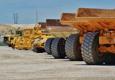 Row of dump trucks Royalty Free Stock Images